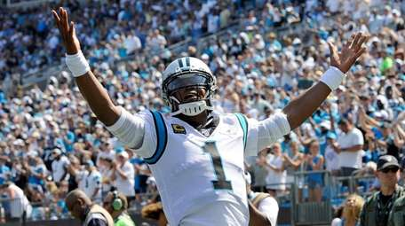 Panthers quarterback Cam Newton celebrates following running back