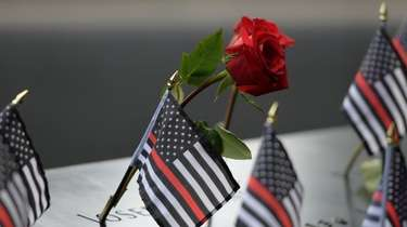 Flowers and flags left for those who died