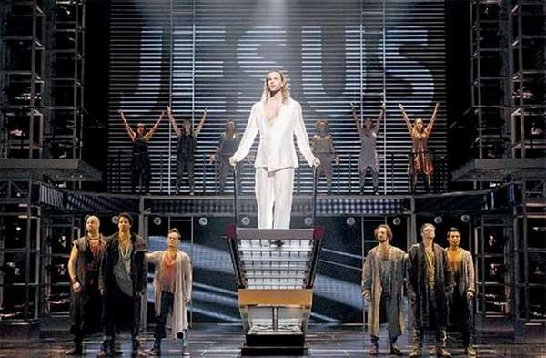"Paul Nolan, center, and the company of ""JCS."""