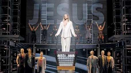 """Paul Nolan, center, and the company of """"JCS."""""""