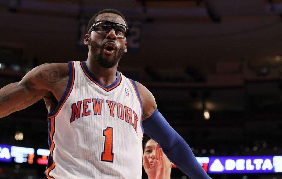 Amar'e Stoudemire celebrates after a blocked shot against