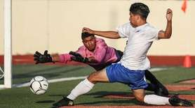 Eric Velasquez of East Meadow scores his second