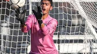 Hicksville goalkeeper Amardeep Singh makes the save against