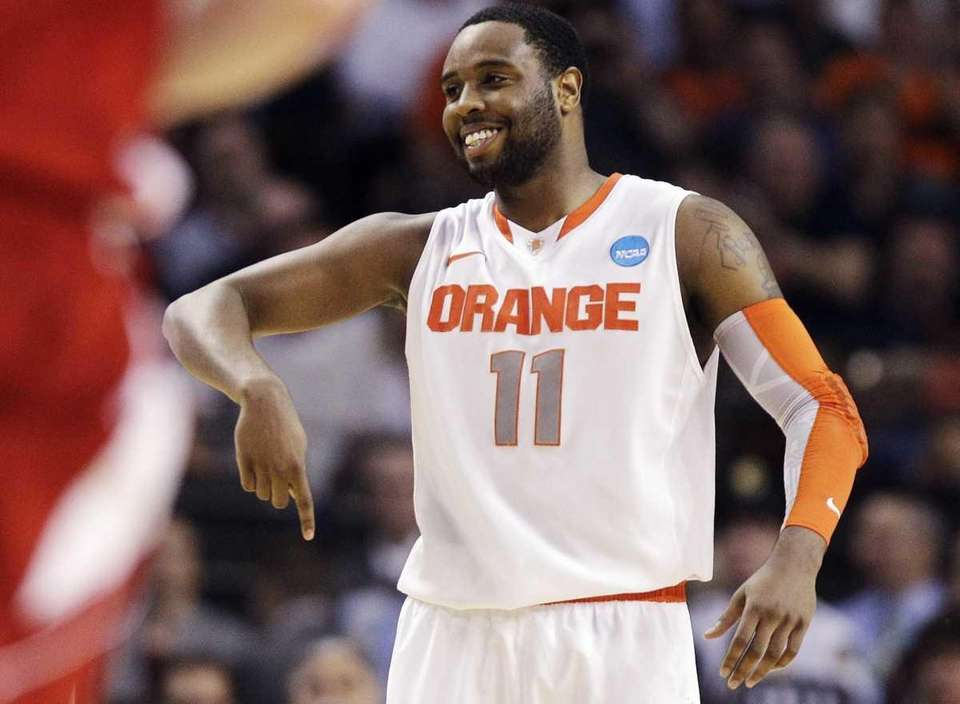Syracuse guard Scoop Jardine (11) reacts in the