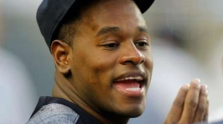 Yankees pitcher Luis Severino looks on from the