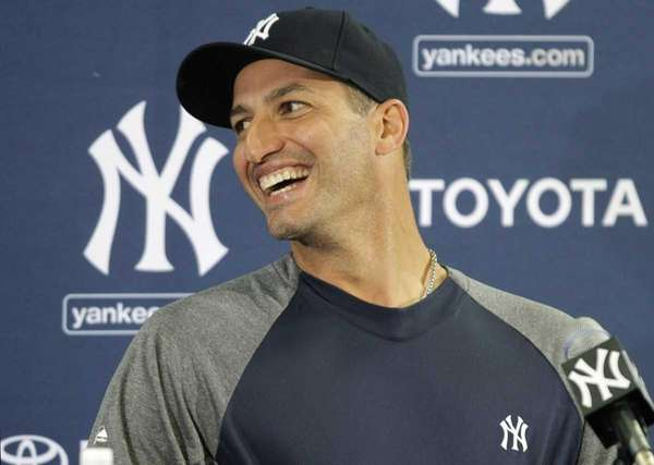 Andy Pettitte speaks to reporters after arriving at