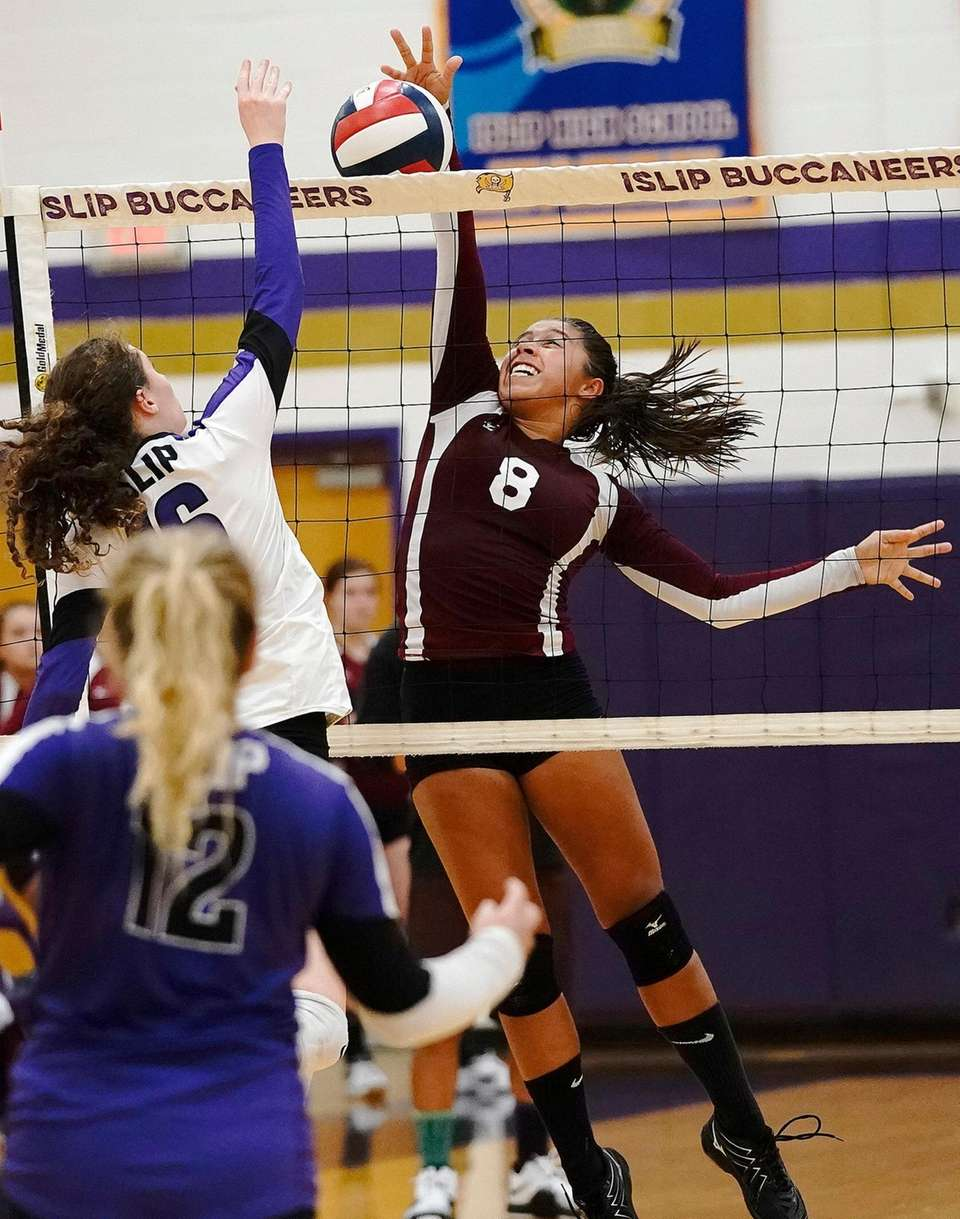 East Hampton's Molly Mamay goes for the block
