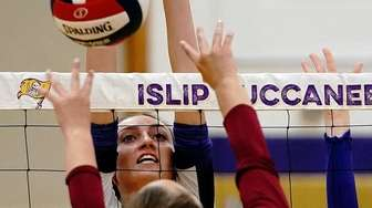 Islip's Emily Vitale (15) blocks the dink shot