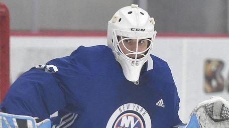 Islanders goalie Jakub Skarek makes a pad save