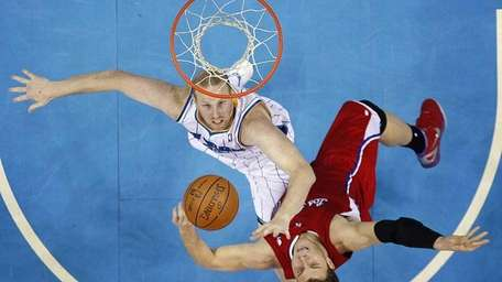 Los Angeles Clippers forward Blake Griffin, bottom, is