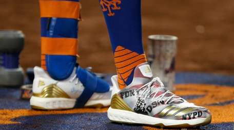 The cleats of J.D. Davis of the Mets