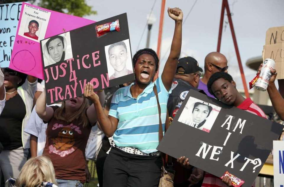 Protestors Lakesha Hall, and her son, Calvin Simms,