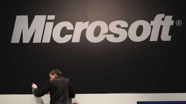 A worker helps prepare the Microsoft stand the