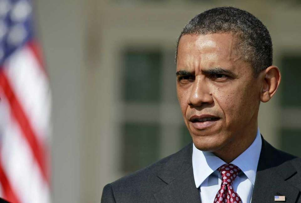 President Barack Obama answers a reporter's question about