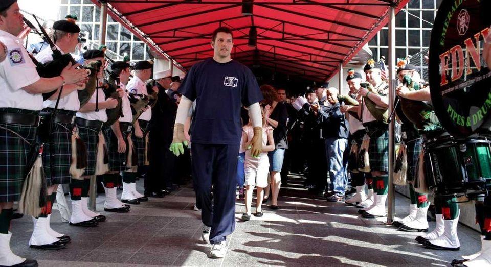 FDNY firefighter Robert Wiedmann of Islip Terrace walks