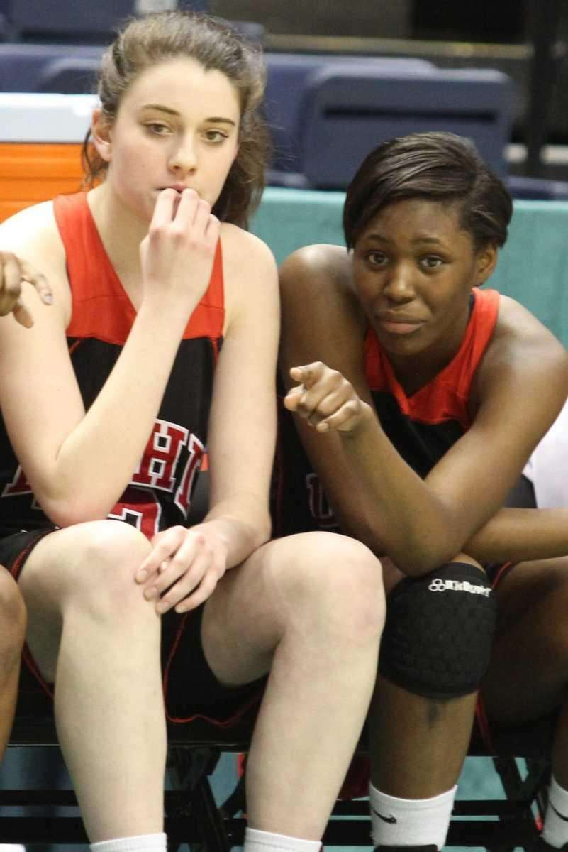 Long Island Lutheran's Staci Barrett, right, gives instructions