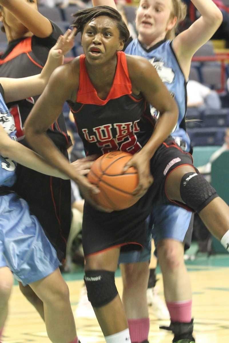 Long Island Lutheran's Staci Barrett grabs a rebound
