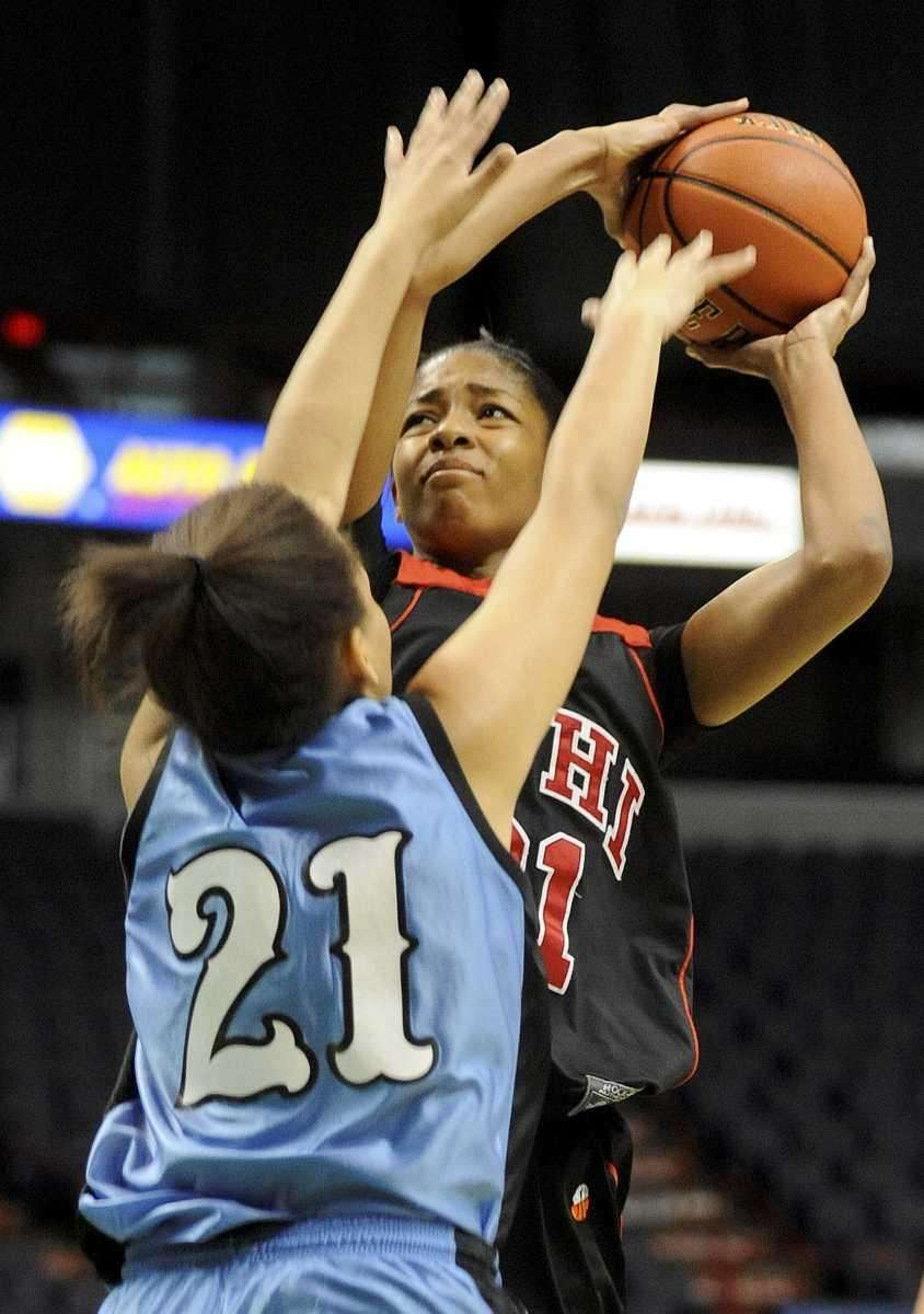 Long Island Lutheran's Sade Gibbons, right, shoots over