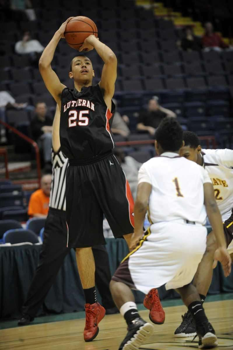 Long Island Lutheran's Anthony Pate puts up a