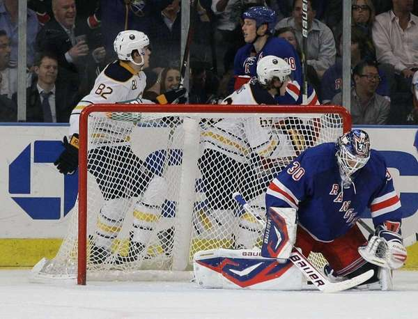 Rangers goalie Henrik Lundqvist reacts as Buffalo Sabres'