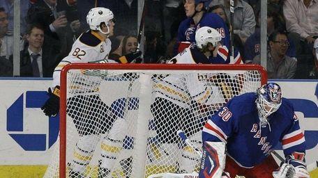 Rangers goalie Henrik Lundqvist reacts as Buffalo Sabres'