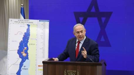Israeli Prime Minister Benjamin Netanyahu shows a map