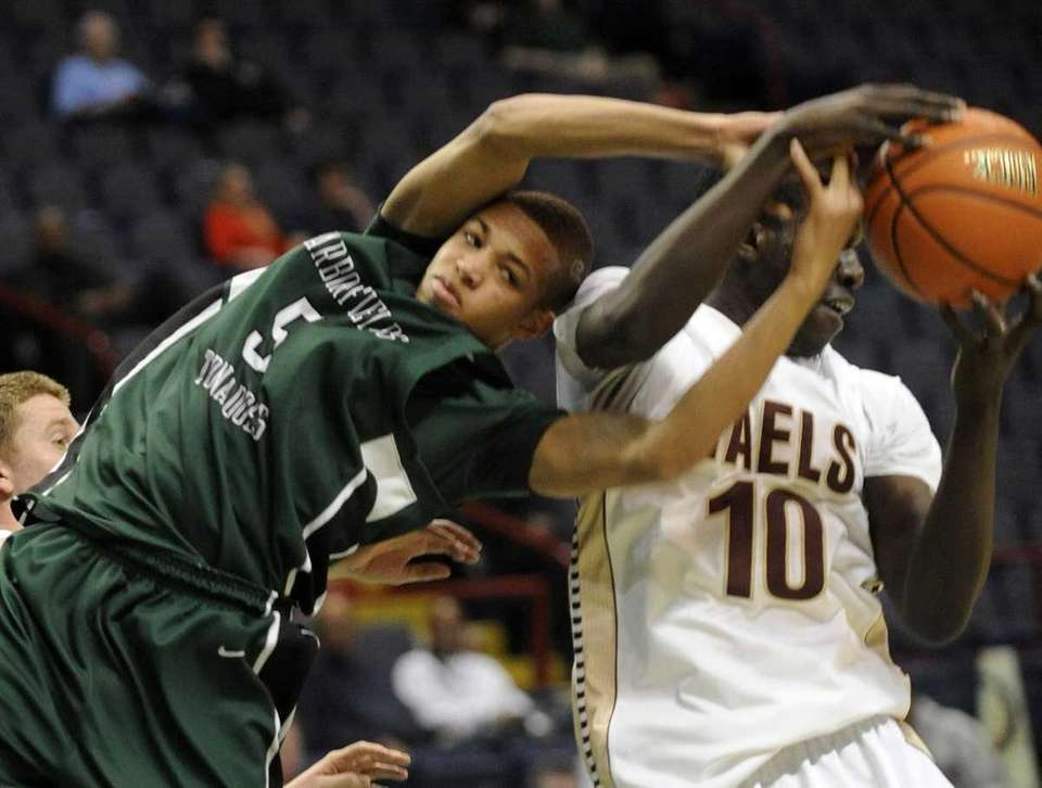 Harborfields' David Ba (5) and Iona Prep's Felix