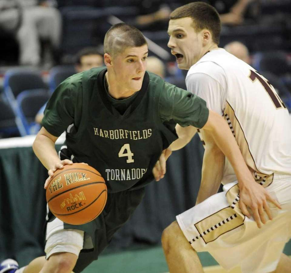 Harborfields' Justin Logrieco Justin Ringen (4) moves the