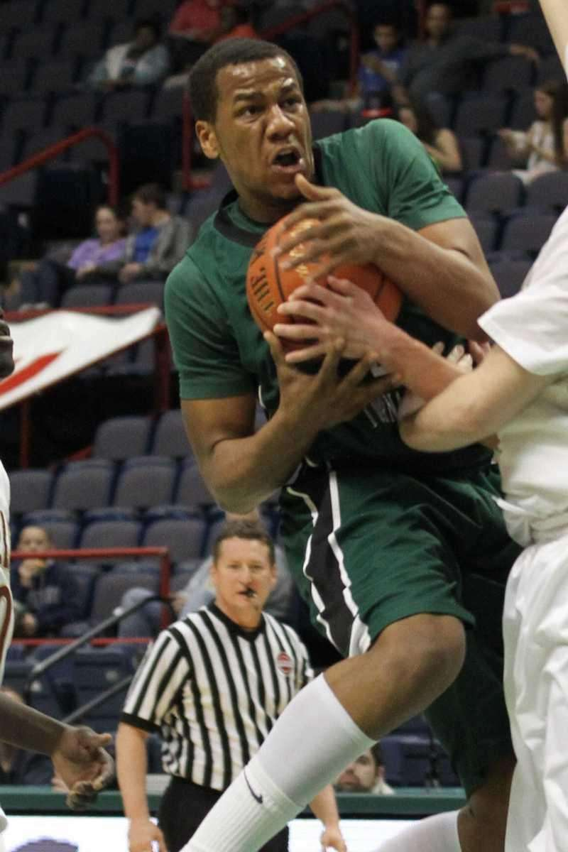 Harborfields' John Patron drives to the basket during