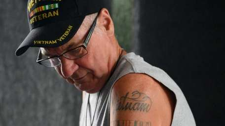 Army veteran Bill Chapman poses for a portrait