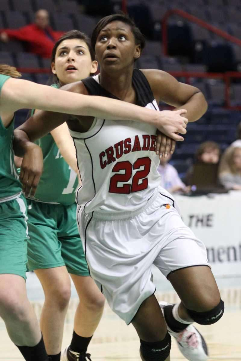 Long Island Lutheran's Staci Barrett boxes out during