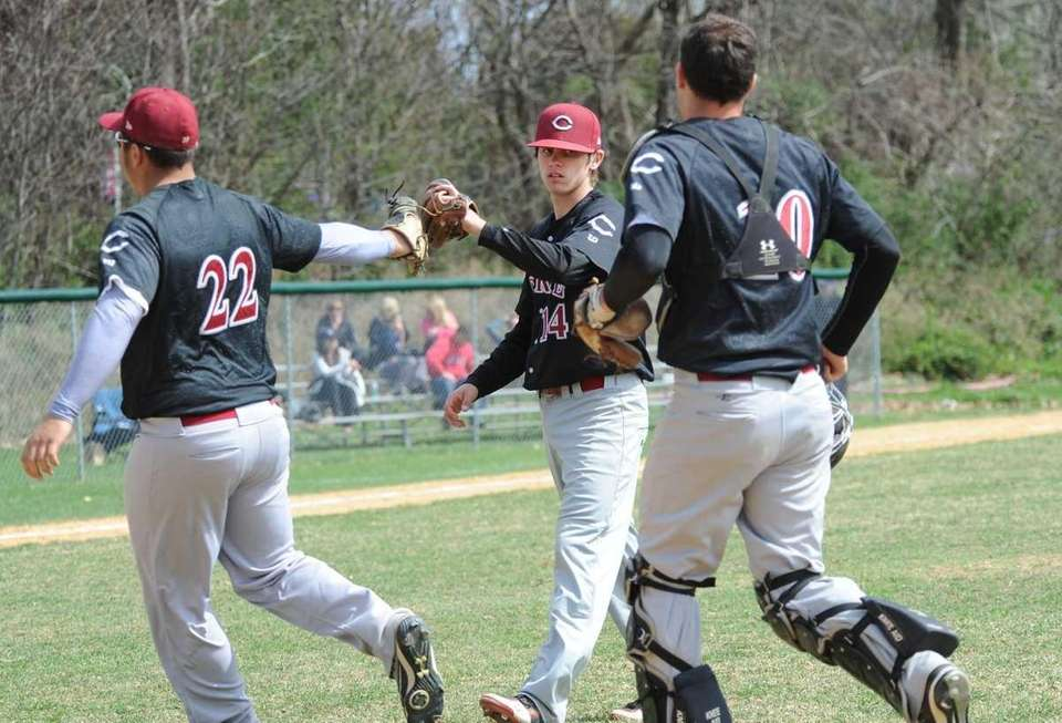 Clarke starting pitcher #14 Chis Appell, center, is
