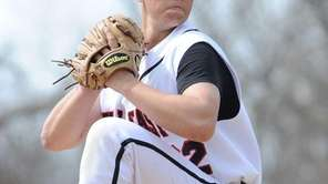 Hills East starting pitcher Stephen Woods delivers in