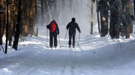 Cross-country skiers tackle a snowy trail at Winding