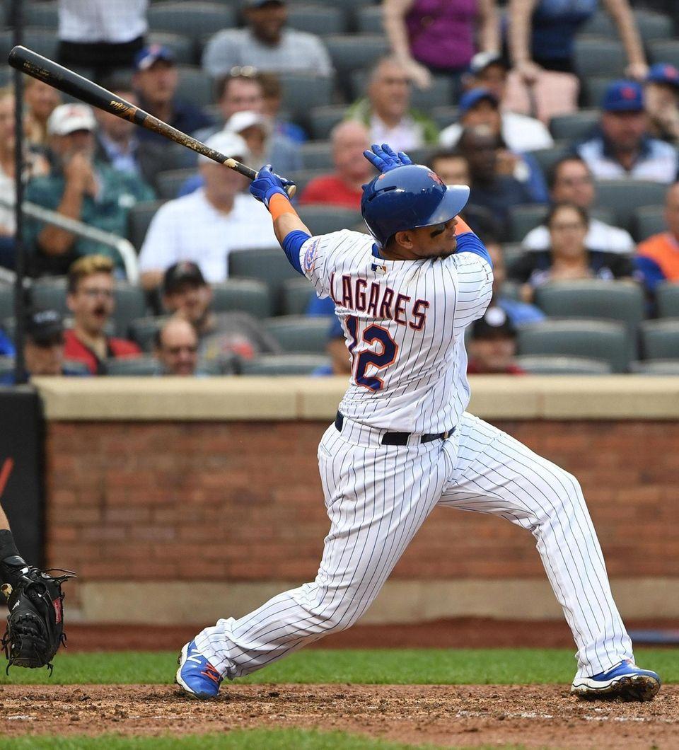Mets centerfielder Juan Lagares hits a grand slam