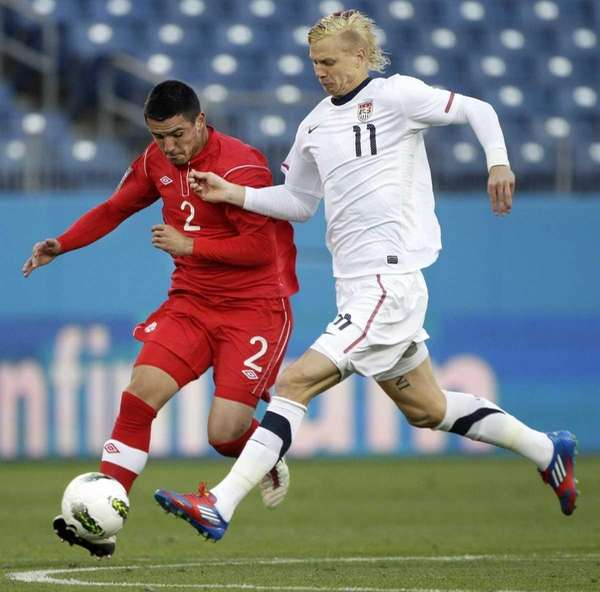 Andres Fresenga of Canada vies for the ball