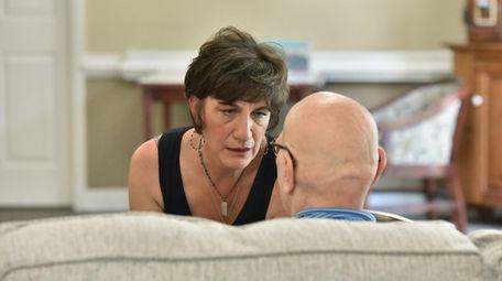 Karen Hardwick talks to her husband, Greg, who