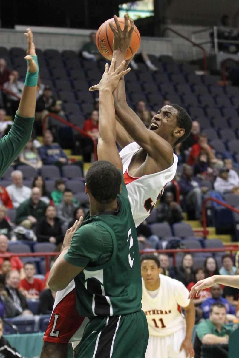 Long Island Lutheran's Kentan Facey goes up for