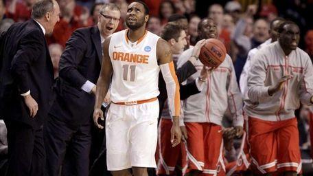 Syracuse guard Scoop Jardine (11) walks past the