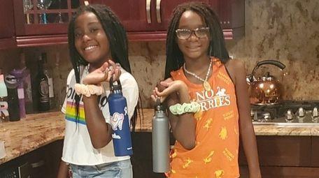 Twins Regan and Bria Baker, 10, of Islip,