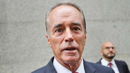 U.S. Rep. Chris Collins, R-N.Y., speaks to reporters