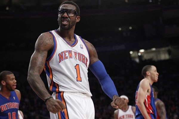 Amar'e Stoudemire reacts to the crowd after scoring