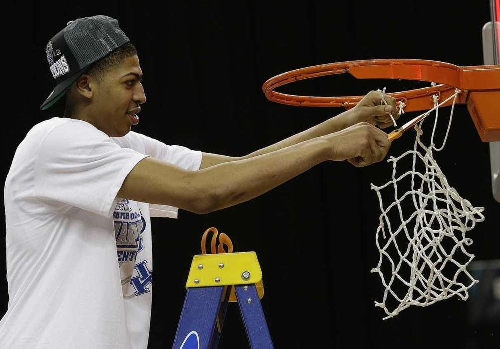 Kentucky's Anthony Davis cuts the net down after