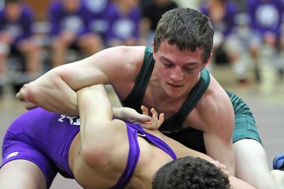Kellenberg's Patrick Skinner wrestling at 113 pounds at