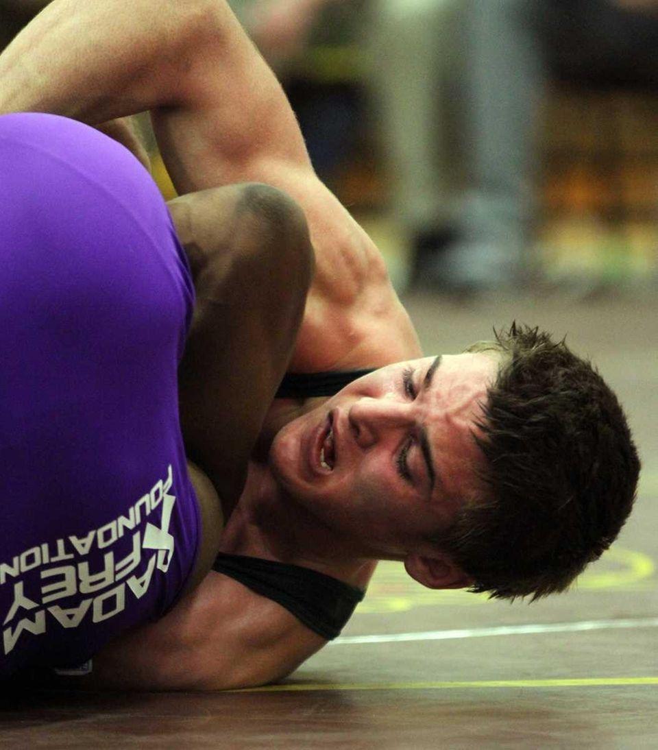 Long Beach's Dylan Palacio (right) wrestling at 152