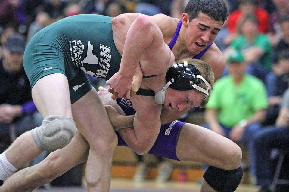 Connetquot's Sean McCabe (front) wrestling at 120 pounds