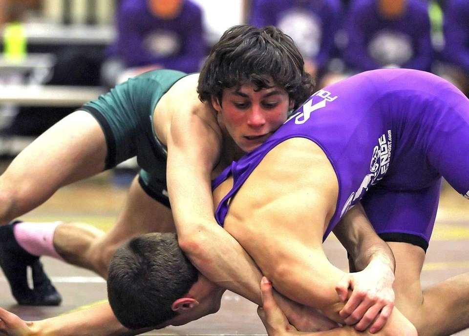Ward Melville's Nick Piccininni wrestling at 106 pounds