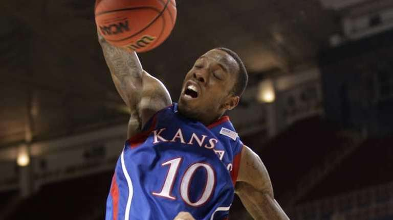 Kansas guard Tyshawn Taylor dunks during the second