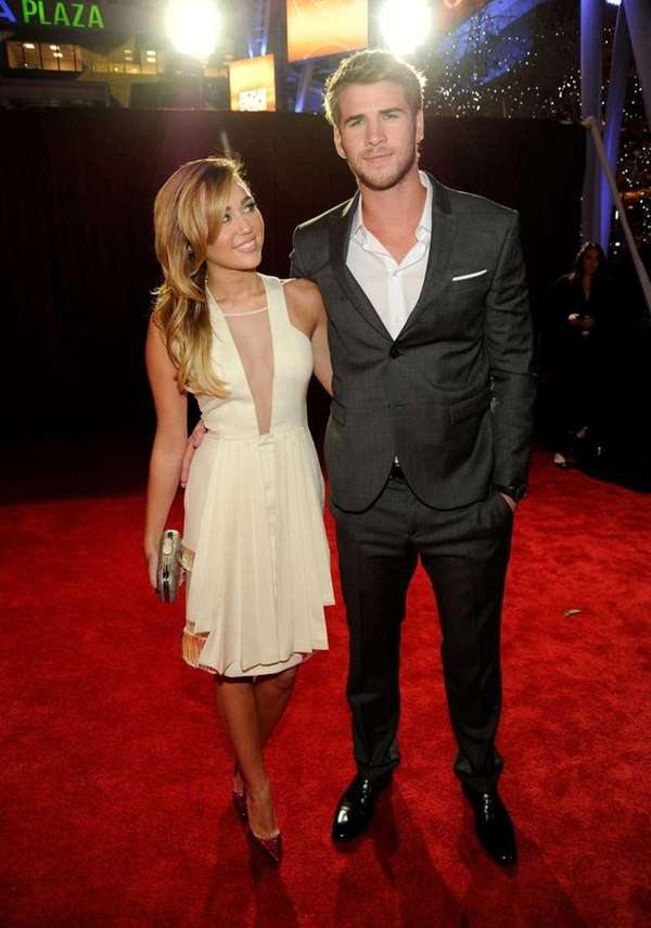 Miley Cyrus and actor Liam Hemsworth arrive at