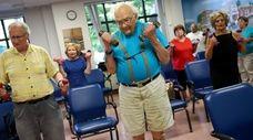 Donald Clarke, 94, center, attends the Huntington Senior
